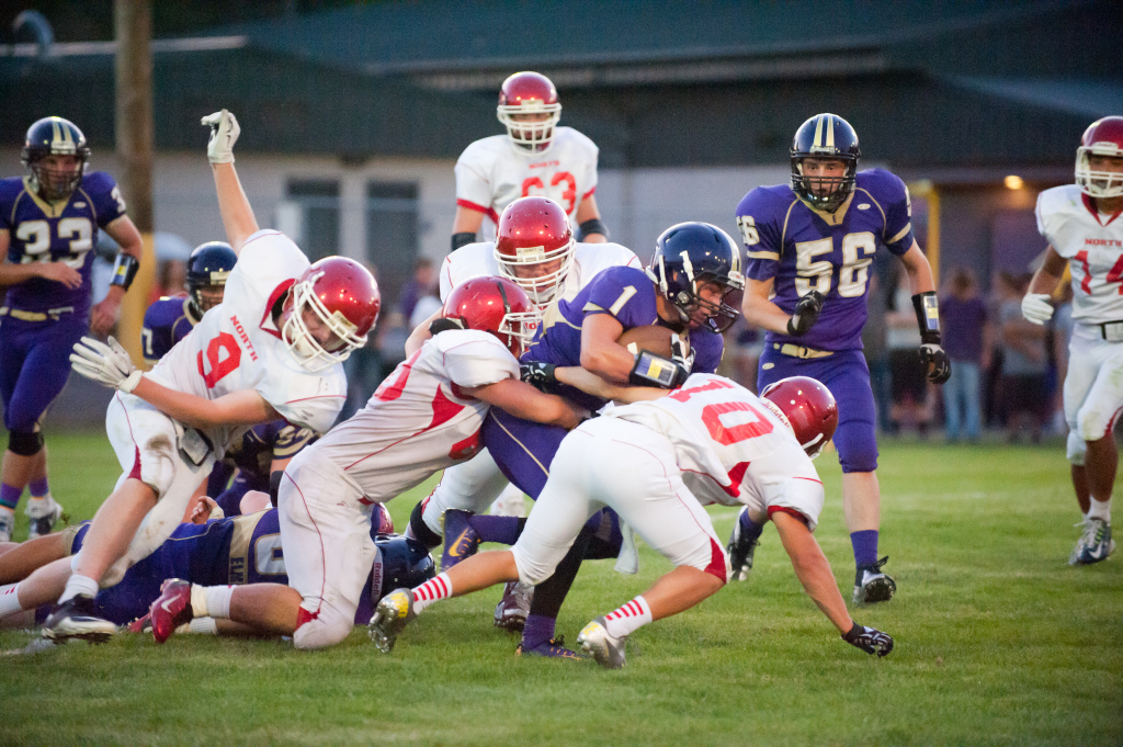 Elmira's Nick Boykin powers through North Eugene tacklers.