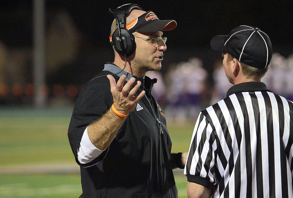 Beaverton coach Bob Boyer chats with game officials during his team's 22-7 win over Sunset at Beaverton High School on Friday night. TIMES PHOTO: MILES VANCE